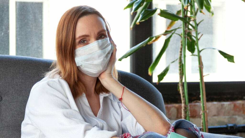 woman struggling with boredom while quarantined
